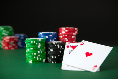 Blackjack and poker chips on the table photo