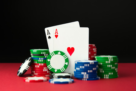 double the chances: Close up of poker aces and casino chips