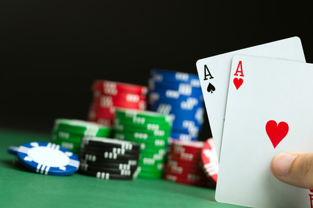 double the chances: Hand with pocket aces during poker game