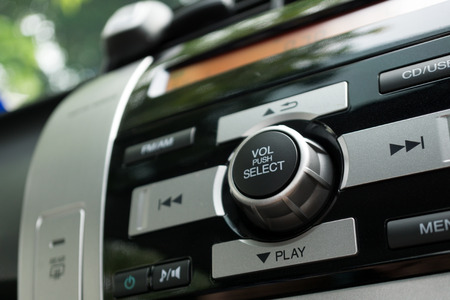 Close up of car radio with focus on the volume button Stock fotó