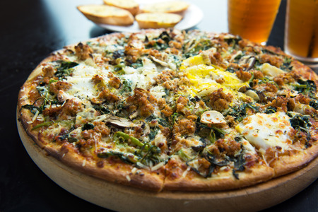 Full size of minced meat, egg and vegetable pizza Stock Photo
