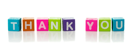 Cubes each with a letter on it written the word thank you photo
