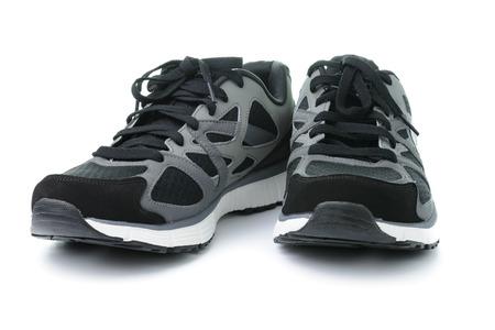 Close up de los hombres zapatos de deporte en el fondo blanco Foto de archivo - 32008899