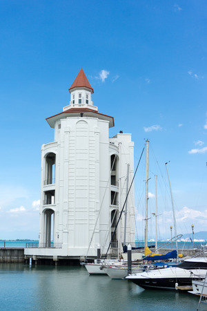 straits: View of Straits Quay lighthouse in Penang, Malaysia against blue sky