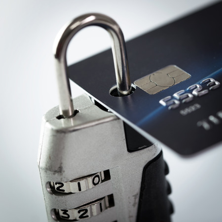 secure payment: Monetary security concept using credit card locked with padlock Stock Photo
