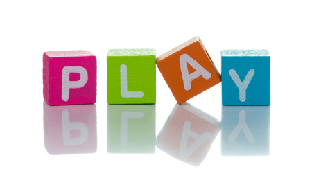 Set of letter cubes spelling the word play photo