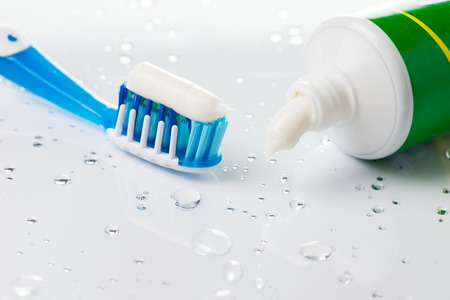 Close up of blue toothbrush and toothpaste tube Stock Photo