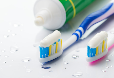 Toothbrushes and toothpaste tube on white background Banco de Imagens