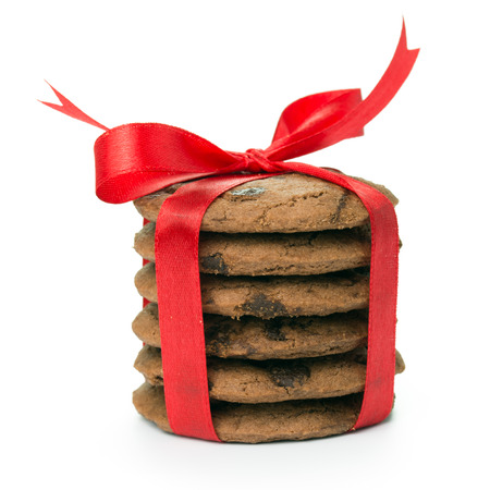 Stack of chocolate chip cookies tied up with red ribbon photo