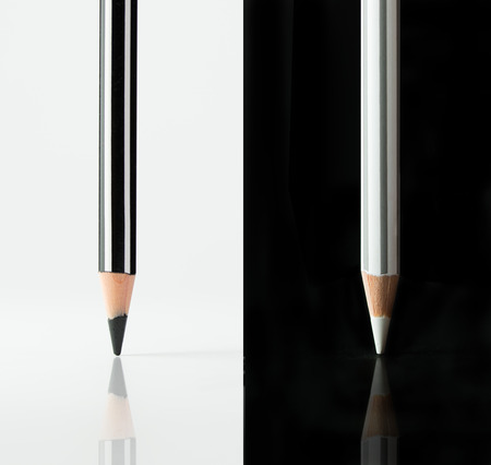 Black and white pencils placed on opposite color