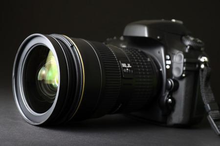 dslr camera: Professional DSLR camera with focus on lens