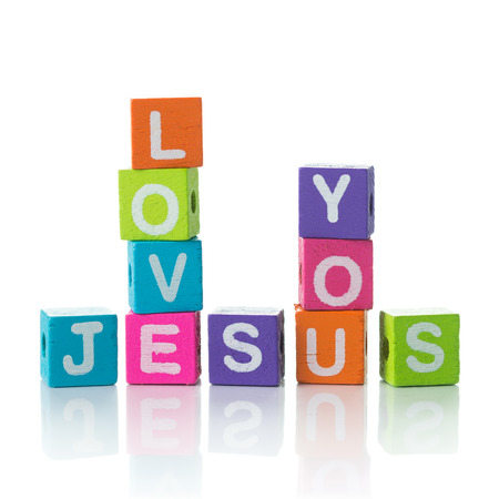 loves: Jesus love you sign illustrated with colorful cubes and arranged in crossword style
