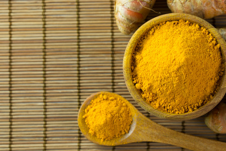 turmeric: Close up of turmeric powder on bamboo mat Stock Photo