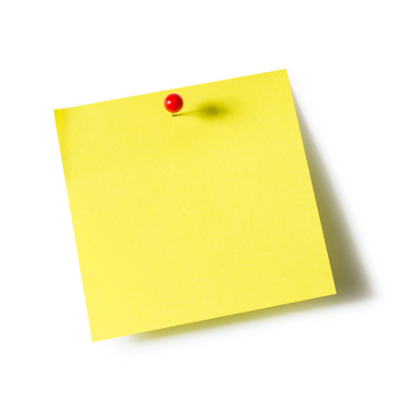 Yellow paper note pad attached with push pin on white background Archivio Fotografico