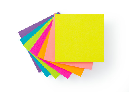 Stack of multicolor sticky note pads on white background 版權商用圖片