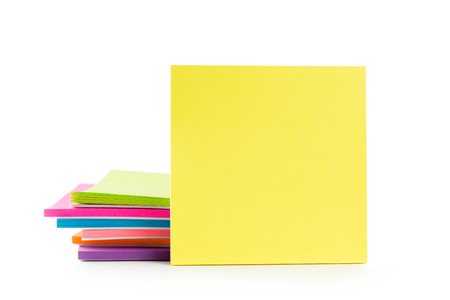 blank note: Stack of multicolor sticky note pads on white background Stock Photo