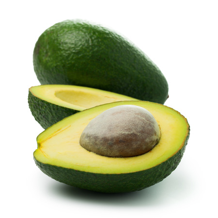 Fresh avocado in halved and whole on white background