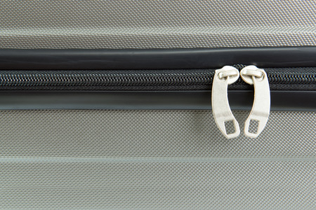 Close up image of a closed suitcase zipper