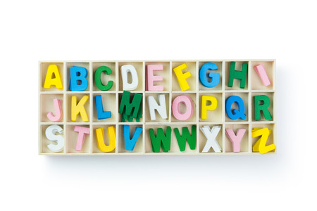 Multicolor wooden alphabet isolated over white background