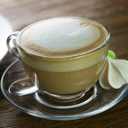 decaffeinated: Cup of cappuccino coffee for afternoon tea break