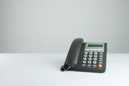 Modern grey color desk telephone isolated on white background