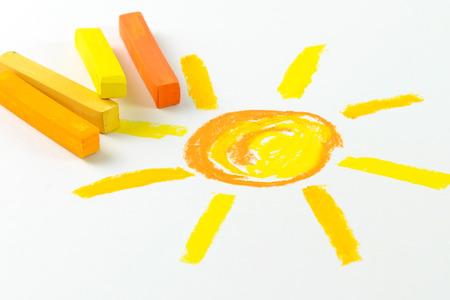 crayon drawing: Child drawing of sun using oil pastel crayon