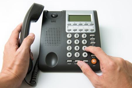 teclado num�rico: Cierre para arriba del hombre de marcaci�n en un tel�fono fijo