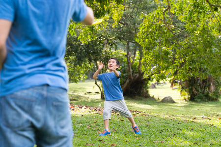 weekend activities: Little Asian boy playing in the park Stock Photo