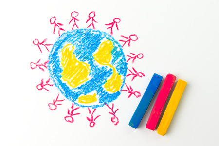 crayon drawing: Child drawing of people standing on the globe