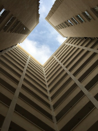 High rise building against blue sky Imagens