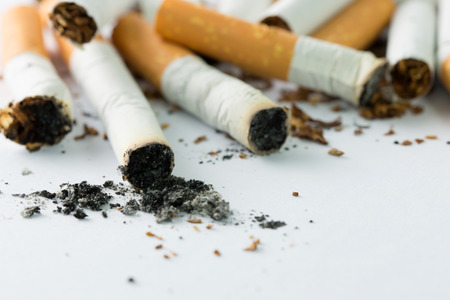 unhealthy living: Close up shoot or cigarettes and ash Stock Photo