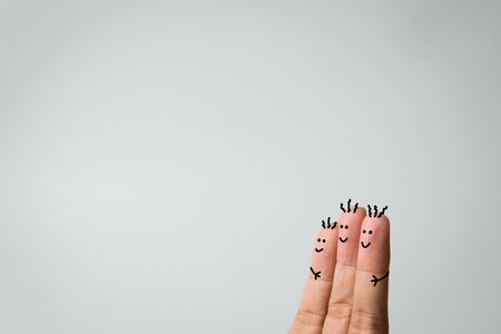Happy three fingers hug on grey background 版權商用圖片 - 38507794