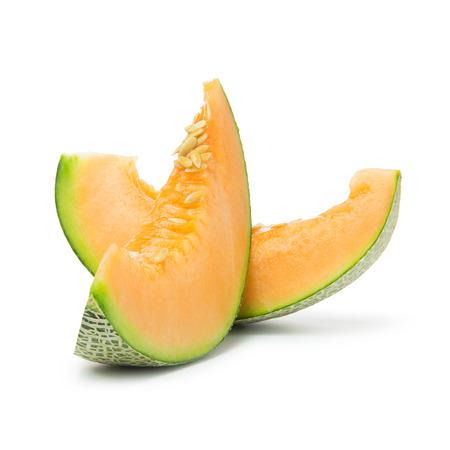 musk: Close up of cantaloupe slices on white background Stock Photo