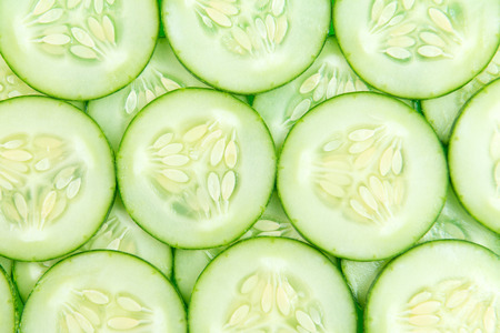 cucumber: Close up of fresh cucumber slices background