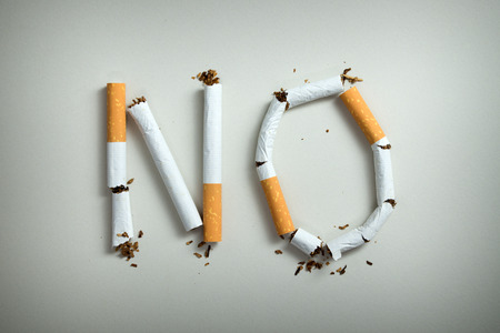 No smoking sign made with broken cigarettes