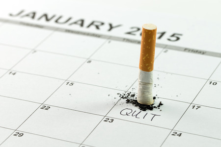 quit: Time to quit smoking concept using cigarette on calendar Stock Photo