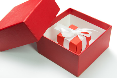 closed ribbon: Red gift box with ribbon on white background