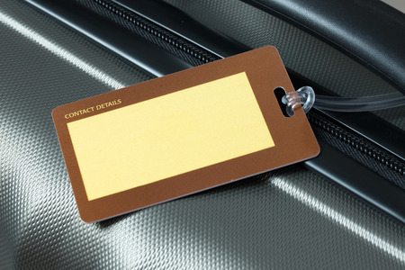 luggage tag: Close up of blank luggage tag on suitcase Stock Photo