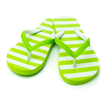 green and white: Pair of green striped sandal on white background