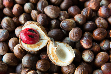 muscat: Close up shot of cut open nutmeg with red seed inside