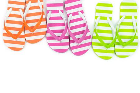 Multicolor striped flip fliops on white background