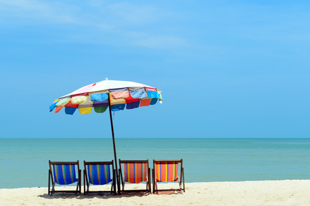deck chairs: Colorful deck chairs with umbrella at the summer beach