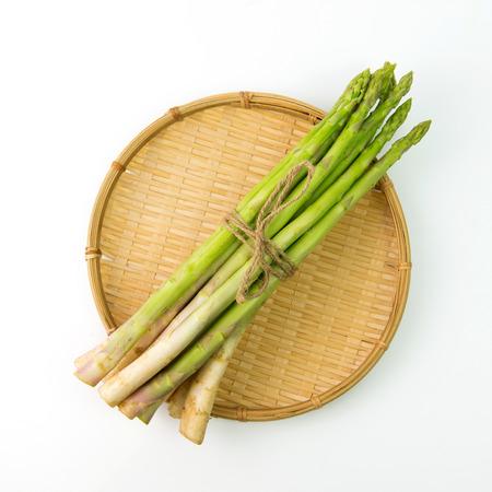 bundle: Bundle of fresh asparagus on bamboo tray basket