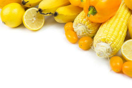 Variety of yellow vegetables and fruits with copy space Stock Photo