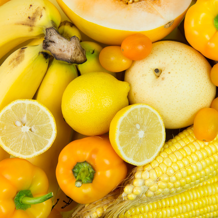 Close up of yellow vegetables and fruits forming background Zdjęcie Seryjne