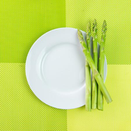bundle: Bundle of fresh asparagus on white plate Stock Photo
