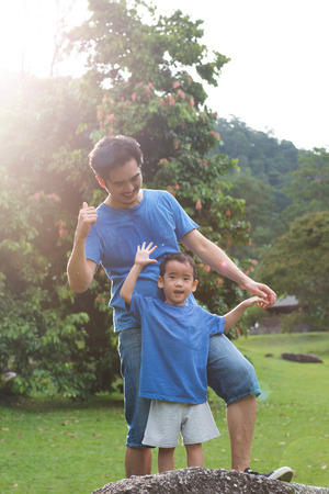 dad son: Portrait of father and son in the park Stock Photo