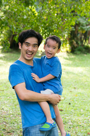 family activities: Portrait of father and son in the park Stock Photo