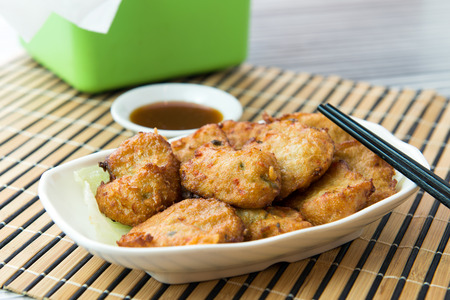 chicken nuggets: Close up of fried chicken nuggets served on white plate