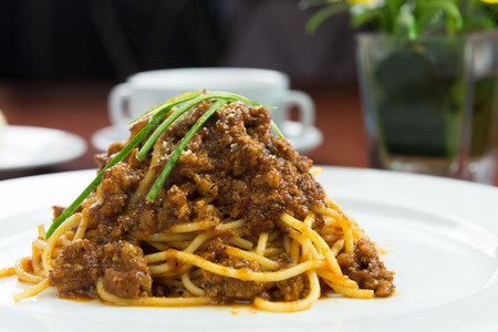 western food: Chicken Bolognese with vegetables and potato wedges